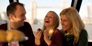 A family enjoy an Afternoon Tea aboard City Cruises