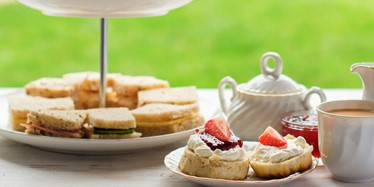 Cornish or Devonshire Method? Afternoon Tea stand featuring scones